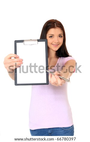 Attractive teenage girl pointing at clipboard. All on white background. - stock photo
