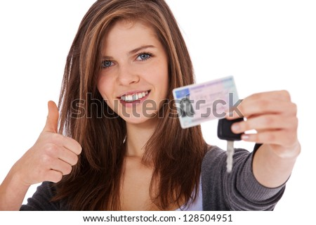 Attractive teenage girl proudly showing her driver's license. All on white background. - stock photo