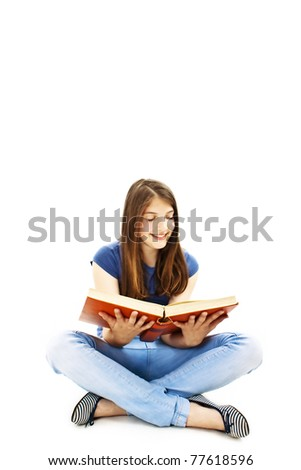 Attractive teenage girl reading a book. All on white background. - stock photo