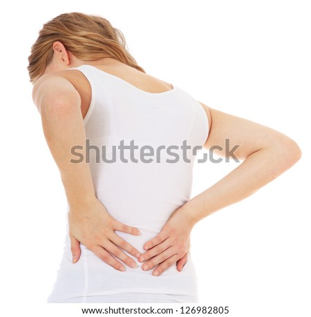 Attractive teenage girl suffers from backache. All on white background. - stock photo