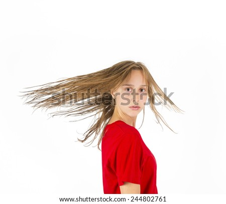 attractive teenage girl with brpown hair in motion - stock photo