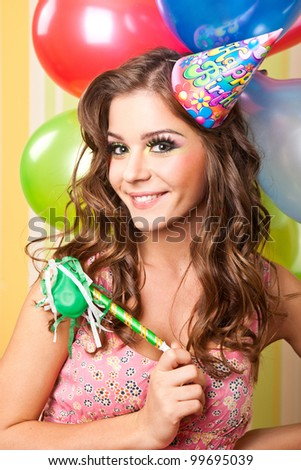attractive teenager celebrating her birthday - stock photo
