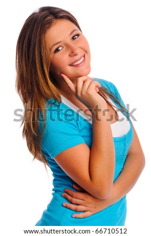 Attractive teenager stands in studio and smiles toward camera - stock photo
