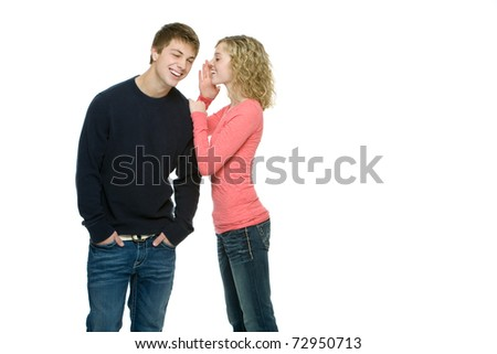 Attractive teenagers gossiping - stock photo