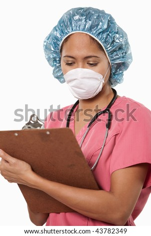 Attractive thirties asian woman doctor nurse wearing facemask - stock photo