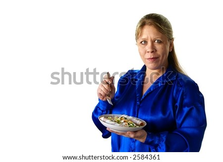Attractive thirty or forty something woman with long blonde hair holding dish of salad on white background.