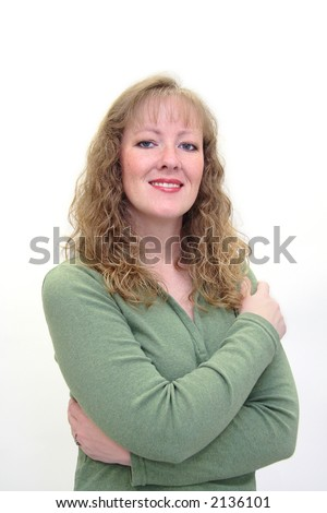 Attractive thirty-something caucasian woman smiling with her arms crossed. Isolated on white. - stock photo