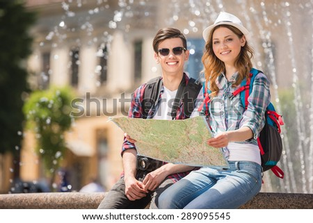 Attractive tourist couple relaxing sightseeing and enjoying traveling together. - stock photo