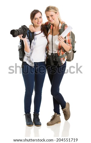 attractive tourists posing for the camera - stock photo