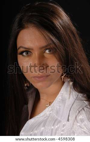Attractive Turkish Business Female looking towards camera - stock photo