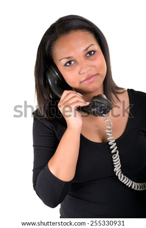 Attractive twenty year old african american woman on telephon over white background. - stock photo