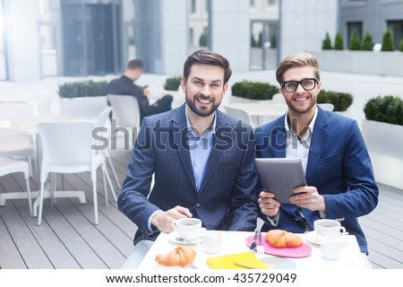 Attractive two business partners are working in cooperation - stock photo