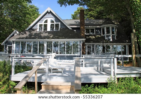 Attractive typical beach house in the midwest, set on a lake. - stock photo