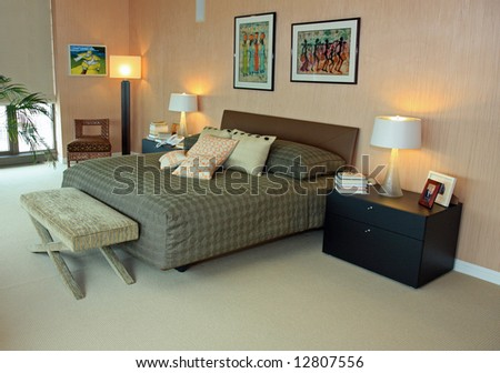 Attractive upscale penthouse master bedroom - stock photo