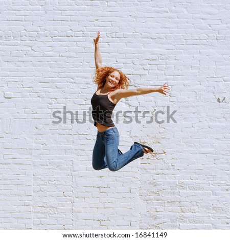 Attractive urban girl against white brick wall. - stock photo