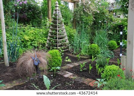 Attractive vegetable and fruit garden. - stock photo