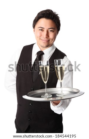 Attractive waiter serving 2 glasses of champagne. Wearing a white shirt and vest. White background. - stock photo