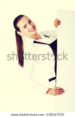 Attractive waitress holding copy space. Isolated on white. - stock photo
