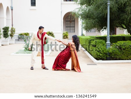 Attractive wedding couple having fun on their wedding day - stock photo
