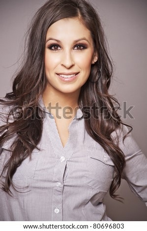 Attractive well dressed young woman with lovely brunette hair - stock photo