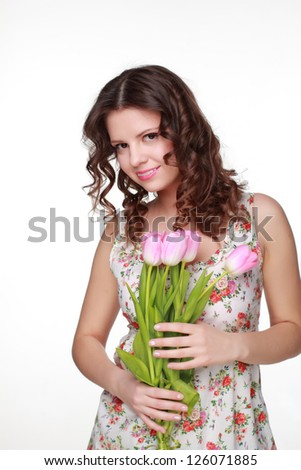 Attractive with beautiful blossom flowers and wearing clothes with floral ornament on Holiday theme/Portrait  of beautiful smiley girl on Beauty and Fashion theme - stock photo