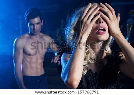 Attractive woman adored by men - stock photo