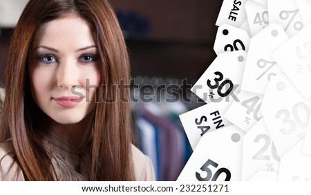 Attractive woman against the background of set of hanger clothes. Sale time - stock photo