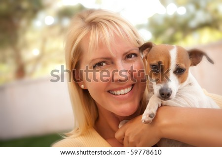 Attractive Woman and Her Jack Russell Terrier Dog Outdoors with Selective Focus. - stock photo