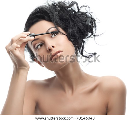 attractive woman applying mascara - stock photo