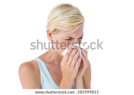 Attractive woman blowing her nose on white background