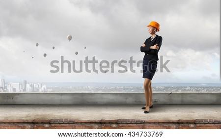 Attractive woman builder - stock photo