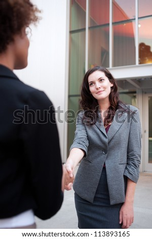Attractive woman business team shaking hands at office - stock photo