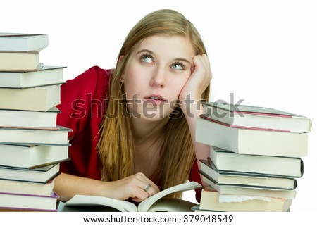 Attractive woman but too bored to study - stock photo