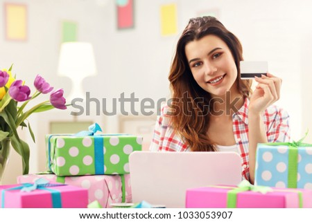 Attractive woman buying easter gifts online stock photo 100 legal attractive woman buying easter gifts online stock photo 100 legal protection 1033053907 shutterstock negle Images