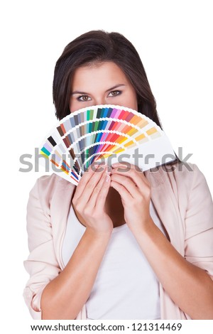 Attractive woman chooses a color scheme. Studio portrait over white - stock photo