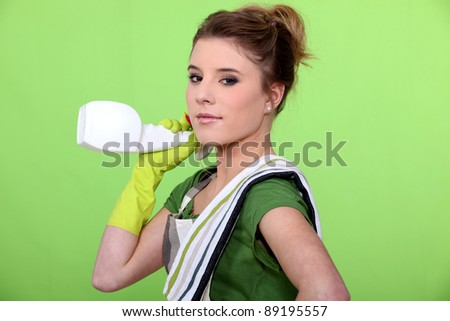 Attractive woman cleaning - stock photo