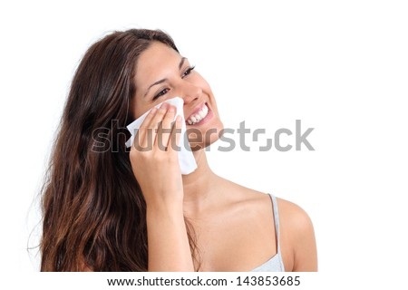 Attractive woman cleaning her face with a face wipe isolated on a white background - stock photo