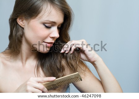 Attractive woman combing her hair