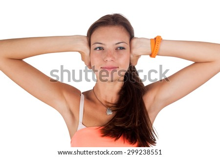 Attractive woman covering her ears - Hear no evil gesture over white background - stock photo