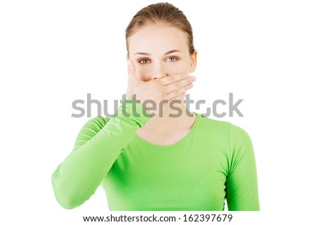 Attractive woman covering her mouth.  Isolated on white.  - stock photo