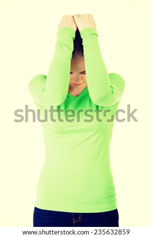 Attractive woman covering herself with both hands.  Isolated on white. - stock photo
