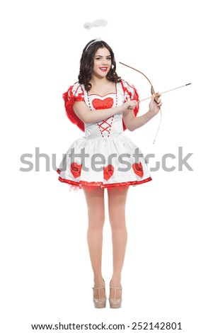 Attractive woman cupid with bow and arrow ready to find love - stock photo
