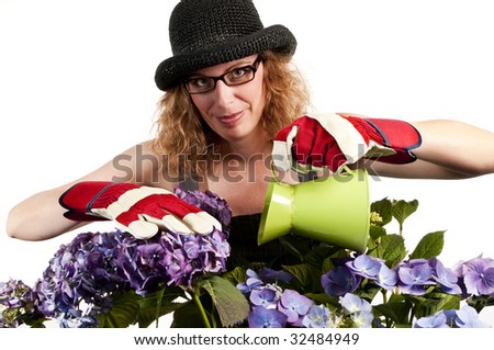 Attractive woman does gardening with watering can on white background - stock photo