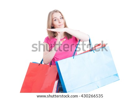 Attractive woman doing timeout or pause gesture while doing shopping isolated on white background with copyspace