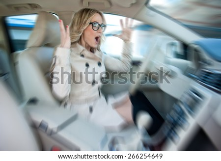 attractive woman driver road rage and panic expression, zoomed for dramatic effect,  - stock photo