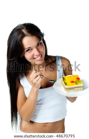 Attractive woman eating a cake. Isolated on white