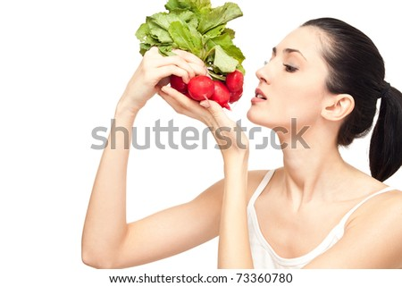 attractive woman eating a healthy dieting food, isolated on white - stock photo