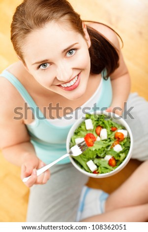 Attractive woman eating fruit salad - stock photo