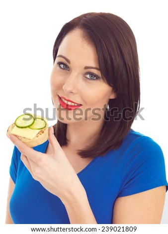Attractive Woman Eating Toasted Crumpet with Cheese and Cucumber - stock photo