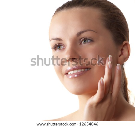 attractive woman enclosing cream smiles - stock photo